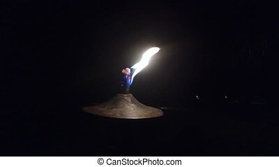 oil lamp or torch flame burning on beach - travel, tourism,...