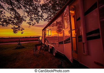 Travel Trailer Camping Spot at Scenic Sunset. Camper...