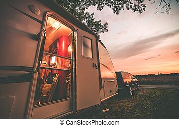 Travel Trailer Camping. RV Trip Theme. Evening in RV ....