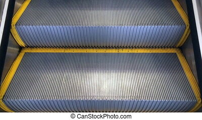 Travel up on Escalator moving staircas