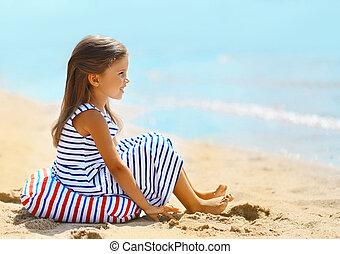 Travel vacation photo pretty little girl enjoying on the beach n