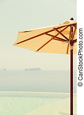 view from infinity edge pool with parasol to sea