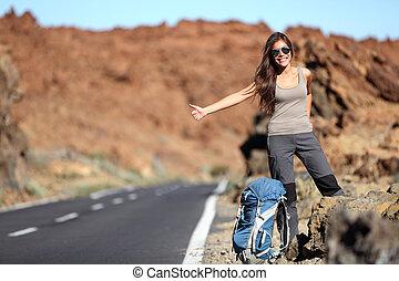 Travel woman hitchhiking