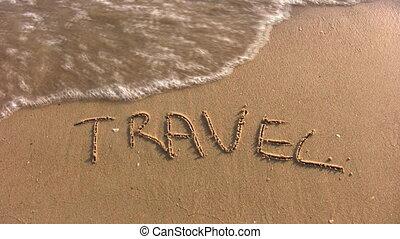 travel word on beach