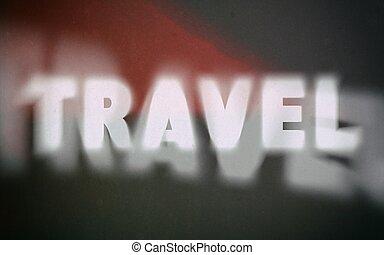 Travel word on vintage blurred background