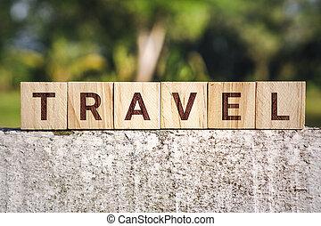 Travel Word on Wooden Block