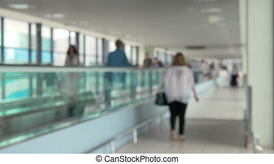 Travelator with people at the airport