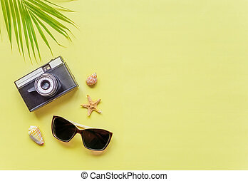 Traveler accessories on yellow background with copy-space