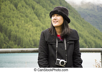 Traveler asian thai woman travel and posing for take photo at Apls mountain and Fedaia Lake in Belluno, Italy.