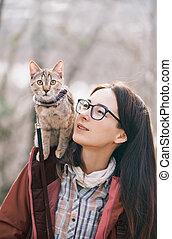 Traveler cat and woman outdoor.