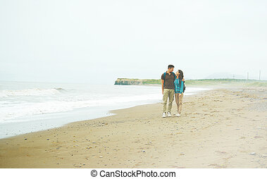 Traveler couple on beach