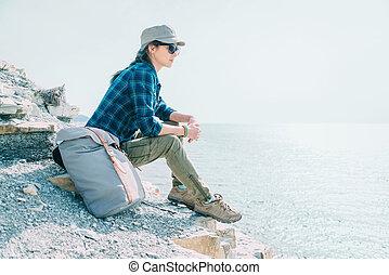 Traveler girl resting on coast