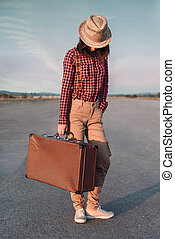 Traveler girl with suitcase