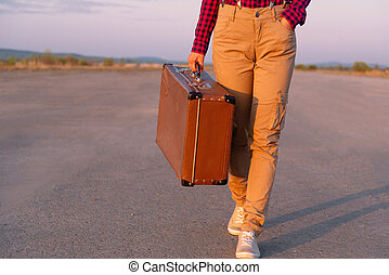 Traveler goes with a suitcase
