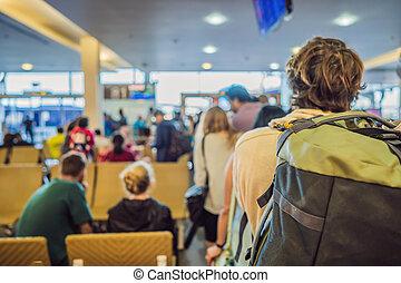 Traveler man backpacker preparing to land on the plane. Travel Concept