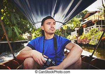 Traveler on the boat