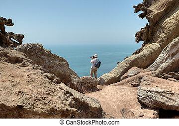 Traveler photographing nature on the Hormuz Island, Hormozgan Province, Iran.