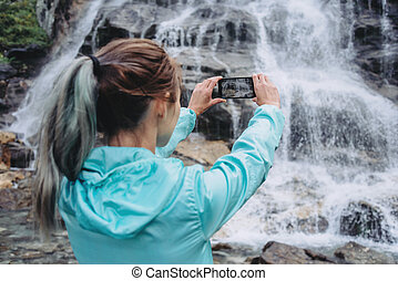 Traveler photographing with smartphone - Traveler young ...
