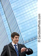 Traveler - Portrait of smart businessman looking at his ...