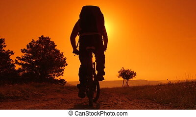 riding mountain bike at sunrise