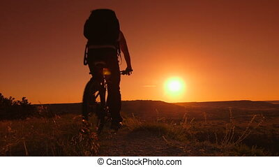 Traveler riding mountain bike