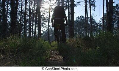 Traveler riding mountain bike