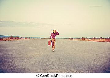Traveler runs with suitcase