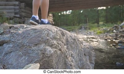 Traveler stepping on the stones at mountain landscape in beautiful sunny summer day in slow motion. Close up. 1920x1080