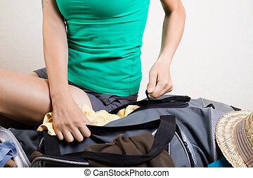 Traveler struggling with suitcase