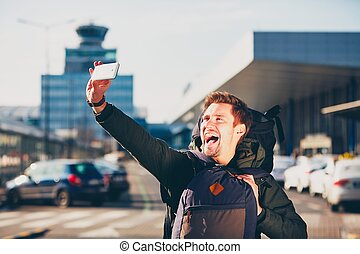 Traveler taking a selfie at the airport