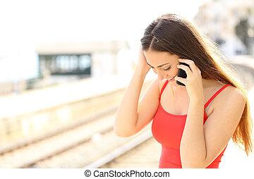 Traveler talking on the mobile phone