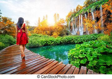Traveler walk on path in Plitvice Lakes, Croatia.