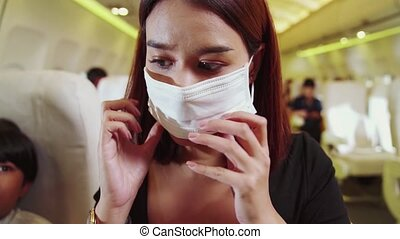 Traveler wearing face mask while traveling on commercial ...