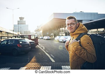 Traveler with backpack at airport