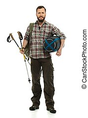 Traveler with backpack, hiking poles and sleeping bag