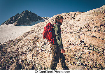 Traveler with backpack hiking
