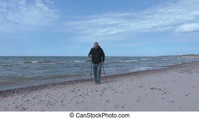 Traveler with hiking sticks keep hands up