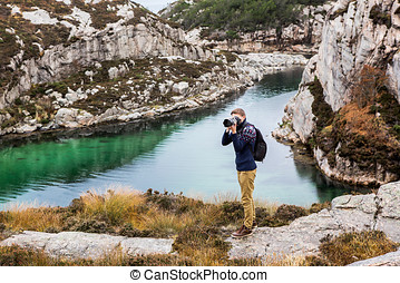 Traveler with professional photo camera