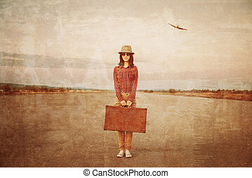 Traveler with suitcase