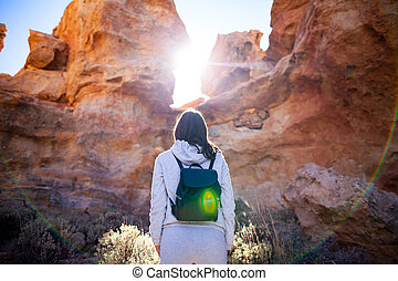 Traveler woman enjoy picturesque mountains in canyon backlit...
