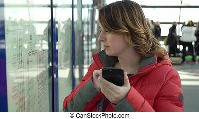 Traveler woman find the best route on map at metro station....