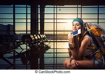 Traveler woman is waiting for a flight