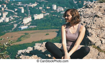 Traveler Woman Sits on Top of a Rocky Mountain. Landscape...