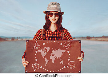 Traveler young woman holding suitcase - Smiling traveler...