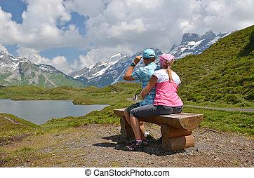 Travelers at a mountain lake. Switzerland