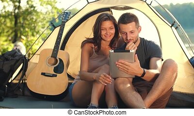 Travelers connected by skype - Young couple backpackers...