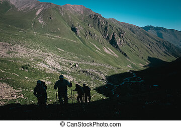 Travelers in the mountains. Mountain landscape and people.