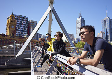 travelers on bridge - 4 young Chinese on bridge Melbourne
