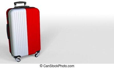 Traveler's suitcase featuring flag of Indonesia. Indonesian...