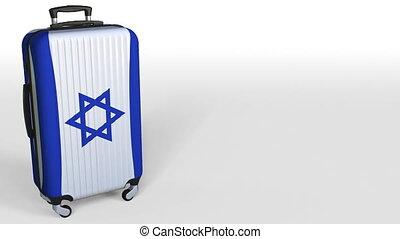 Traveler's suitcase featuring flag of Israel. Israeli...